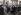 Arsène Tchakarian (1916-2018), résistant français d'origine arménienne, membres des FTP-MOI (Francs-tireurs et partisans - main-d'œuvre immigrée (FTP-MOI), dirigé par Missak Manouchian, au cimetière d'Ivry-sur-Seine (Val-de-Marne), février 1945. © Archives Manouchian / Roger-Viollet