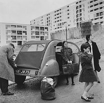 A family in front of their Citroën 2CV. Parisian suburbs, 1950s. Photograph by Janine Niepce (1921-2007). © Janine Niepce / Roger-Viollet