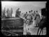"""Lancement du pont de bateaux français sur le Rhin, reliant les localités de Saint-Goar et de Saint-Goarhausen, le 10 janvier 1919. Arrivée de la canonnière """"Argonne"""" ayant à son bord le général Mangin. Le général Mangin débarque sur l'amorce de la rive droite. Photographie parue dans le journal """"Excelsior"""" du mercredi 15 janvier 1919. © Excelsior - L'Equipe / Roger-Viollet"""