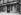Guerre 1914-1918. Protection des vitrines contre les bombardements. Tailleur, boulevard du Montparnasse. Paris, 1918. © Jacques Boyer / Roger-Viollet