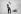 Enfant remontant la pente avec sa luge. Megève (Haute-Savoie), 1954. Photographie de Janine Niepce (1921-2007). © Janine Niepce / Roger-Viollet