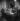 Olivier Messiaen, compositeur français avec Yvonne Loriod, pianiste française, à droite et derrière eux, Karlheinz Stockhausen, compositeur allemand. Paris, mars 1952. © Boris Lipnitzki / Roger-Viollet