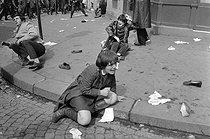 """Events of May-June 1968. Demonstrators wounded during the first violent confrontations with the police forces in the Latin Quarter. Paris (Vth arrondissement), on May 6, 1968. Photograph by Jacques Boissay and Bernard Charlet, from the collections of the French newspaper """"France-Soir"""". Bibliothèque historique de la Ville de Paris. © Boissay,Charlet / Fonds France-Soir / BHVP / Roger-Viollet"""