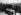 Inhumation du Soldat inconnu sous l'Arc de Triomphe. Louis Barthou (1862-1934), ministre de la guerre, disposant sur le cercueil la Légion d'Honneur, la médaille militaire et la croix de guerre. Paris (VIIIème arr.), 28 janvier 1921. © Roger-Viollet