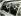 Mohammad Zaher Shah (1914-2007), roi d'Afghanistan, et John F. Kennedy (1917-1963), homme d'Etat américain, assis à l'arrière d'une limousine. Washington DC (Etats-Unis), 9 mai 1963. © TopFoto / Roger-Viollet