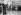 Spectacle improvisé sur les Grands Boulevards, après un orage. Pêcheur à la ligne dans une flaque d'eau. Paris, vers 1925.   © Albert Harlingue/Roger-Viollet