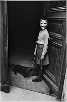 Young masked girl with her dog, boulevard Beaumarchais. Paris (IIIrd arrondissement), 1970's. Photograph by Léon Claude Vénézia (1941-2013). © Léon Claude Vénézia/Roger-Viollet