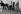 """Michel Legrand (assis), Norman Maen, Catherine Deneuve et Françoise Dorléac, pendant le tournage du film """"Les Demoiselles de Rochefort"""", 1966. Photographie de Georges Kelaïditès (1932-2015). © Georges Kelaïditès / Roger-Viollet"""