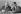 Claude Estier (1925-2016), journaliste et homme politique français, et Pierre Bérégovoy (1925-1993), homme politique français et Premier ministre de François Mitterrand de 1991 à 1993. © Jacques Cuinières / Roger-Viollet