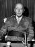 Le général Francisco Franco Bahamonde (1892-1975), homme d'Etat espagnol, en uniforme lors d'un discours à la radio. 1969. © Ullstein Bild / Roger-Viollet