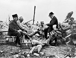 Guerre 1914-1918. Georges Clemenceau (1841-1929), homme politique français, déjeunant avec son fils le capitaine Paul Clemenceau (à sa droite) et le capitaine Delorme ( à gauche), sur le front, dans les ruines de l'église de Maurepas (Somme). 10 octobre 1916. © Albert Harlingue / Roger-Viollet
