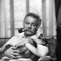 Georges Brassens (1921-1981), French singer-songwriter, at home. Paris, 1974.   © Patrick Ullmann/Roger-Viollet