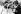 Jim Clark (1936-1968), pilote automobile écossais, et Graham Hill (1939-1975), pilote automobile britannique, vainqueur du titre de champion du monde après sa victoire lors du Grand Prix d'Afrique du Sud, 29 décembre 1962. © TopFoto / Roger-Viollet