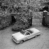 Jean-Pierre Melville (1917-1973), cinéaste français, dans sa voiture Plymouth. France, vers 1956. © Gaston Paris / Roger-Viollet