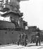 """Guerre 1939-1945. Le maréchal Pétain (1856-1951) et l'amiral Darlan (1881-1942) devant le """"Strasbourg"""" en rade de Toulon (au 2ème rang, l'amiral de Laporte, commandant en chef des Forces navales d'Outre-Mer). Mars 1942. © LAPI/Roger-Viollet"""