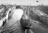 """Canal de Panama. Passage du premier bateau remorqueur """"Gatun"""" dans les écluses supérieures de Gatun. 26 septembre 1913. © Jacques Boyer / Roger-Viollet"""