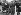 Femme vendant du muguet dans la rue pour le 1er mai. Paris, vers 1930. © Imagno/Roger-Viollet