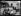 """""""Le départ des derniers internés allemands"""", en octobre 1919. """"Les derniers sujets allemands internés pendant la guerre dans les camps de concentration français s'en vont. Déjà, les Autrichiens sont partis. Un grand départ vient d'avoir lieu à Viviers-sur-Rhône, dans l'Ardèche. Aux 403 internés que contenait déjà le séminaire de cette localité sont venus s'ajouter 71 disciplinaires de Saint-Tropez, 103 internés du Puy, 12 de Garaison, 80 de Villefranche-de-Rouergue. Au total, 670 indésirables, dont plusieurs femmes françaises épouses d'Allemands, et des enfants nés en captivité pendant la guerre. Beaucoup de ces gens avaient demandé leur internement au début des hostilités"""". Les internés de la Chartreuse du Puy. Photographie parue dans le journal """"Excelsior"""" du mercredi 22 octobre 1919. © Excelsior – L'Equipe/Roger-Viollet"""