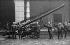 Services des Sapeurs-Pompiers de la Ville de Paris. Grande échelle de sauvetage et sapeurs en tenue de feu, vers 1900.     © Neurdein/Roger-Viollet