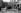 Le garde champêtre de la commune de Montmartre ouvrant le défilé lors d'une fête. Paris, vers 1925. © Albert Harlingue/Roger-Viollet