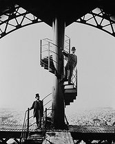 Gustave Eiffel and Salles, his son-in-law and co-worker, at the top of the Eiffel Tower. Paris, 1889. © Neurdein/Roger-Viollet