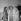 """Jean Marais rendant visite au réalisateur Marc Allégret (à droite), dirigeant le film """"Sois belle et tais-toi"""". A gauche : Béatrice Altariba. A droite : Alain Delon. 1957.   © Alain Adler / Roger-Viollet"""