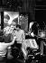 """Mick Jagger (né en 1943), chanteur et musicien britannique, et Ian Stewart (1935-1985), musicien anglais, membres du groupe vocal anglais The Rolling Stones, lors d'une répétition pour l'émission de télévision """"Ready Steady Go!"""". Angleterre, 1964-1966. Photographie de Mick Ratman. © Mick Ratman / TopFoto / Roger-Viollet"""