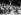 Guerre 1939-1945. Le maréchal Pétain, l'amiral Darlan et François Valentin, pendant la prestation de serment de la fête de la Légion française des combattants, retransmise et faite en même temps dans les principales villes de la zone non occupée, au stade. Vichy (Allier), septembre 1941. © LAPI/Roger-Viollet