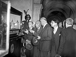 Robert Schuman (1886-1963), homme politique français, visitant une exposition sur Jeanne d'Arc (1412-1431), héroine française. Derrière lui : Max Lejeune. Paris, 1948. © Roger-Viollet