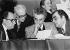 Meeting du Parti socialiste. François Mitterrand, Jean Poperen (debout), Lionel Jospin et Pierre Bérégovoy. Alfortville (Val-de-Marne), janvier 1980. © Jacques Cuinières / Roger-Viollet