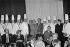"""Le président Giscard d'Estaing décore d'une médaille les meilleurs ouvriers de France, lors de """"la semaine du travail manuel"""". A gauche : J. Rebuchon, au centre : P. Bocuse, à droite : Léon Zitrone. 13 décembre 1976. © Jacques Cuinières / Roger-Viollet"""