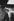 """Une femme suivant une méthode de contraception naturelle dite la """"méthode Ogino"""", consulte un calendrier. Photographie de Janine Niepce (1921-2007). © Janine Niepce / Roger-Viollet"""