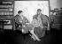 Foujita (1886-1968), peintre français d'origine japonaise, chez lui, avec un modèle.     © Albert Harlingue/Roger-Viollet