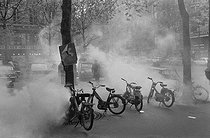 """Events of May-June 1968. Tear gas used during the first student demonstrations in the Latin Quarter, place de la Sorbonne. Paris (Vth arrondissement), on May 3rd, 1968. Photograph by Claude Champinot, from the collections of the French newspaper """"France-Soir"""". Bibliothèque historique de la Ville de Paris. © Claude Champinot / Fonds France-Soir / BHVP / Roger-Viollet"""