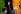 Nelson Mandela (1918-2013), président d'Afrique du Sud, avec son épouse, Winnie Mandela (1936-2018), le poing levé devant des dizaines de  milliers de personnes lors d'un concert en son honneur. Londres (Angleterre), stade Wembley, 29 mars 2007. © PA Archive / Roger-Viollet