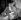 """Jeanne Moreau et Philippe Lemaire pendant le tournage du film de Raymond Bailly """"L'Etrange Monsieur Steve"""", 1957. © Alain Adler/Roger-Viollet"""