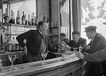Café owner talking to his customers, at the corner of the rue de Varenne and the boulevard des Invalides. Paris (VIIth arrondissement), 1942. Photograph by René Giton (known as René-Jacques, 1908-2003). Bibliothèque historique de la Ville de Paris. © René-Jacques / BHVP / Roger-Viollet