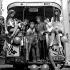Les membres du groupe The Who, accompagnés de deux femmes et d'un éléphant, à bord d'un bus du studio Lime Grove. Angleterre, 9 octobre 1968. © PA Archive/Roger-Viollet