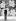 """Andy Warhol (1928-1987), artiste et cinéaste américain, devant son oeuvre sérigraphique """"Fleurs"""" (1970). © TopFoto / Roger-Viollet"""