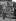Vendeur de journaux devant un omnibus. Paris, 1899.      © Jacques Boyer/Roger-Viollet