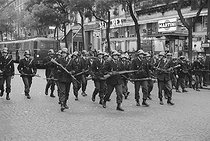 """Events of May-June 1968. Police cordon during a demonstration of """"Occident"""", French far-right militant political group. Paris (VIIIth arrondissement), on May 21st, 1968. Photograph by Claude Champinot, from the collections of the French newspaper """"France-Soir"""". Bibliothèque historique de la Ville de Paris. © Claude Champinot / Fonds France-Soir / BHVP / Roger-Viollet"""