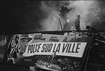 """Events of May-June 1968. Barricades are removed after the second night of the barricades, boulevard Saint-Michel. Paris (VIth arrondissement), on May 24, 1968. Photograph by Claude Champinot, from the collections of the French newspaper """"France-Soir"""". Bibliothèque historique de la Ville de Paris. © Claude Champinot / Fonds France-Soir / BHVP / Roger-Viollet"""