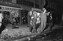 """May-June 1968 events. Man seriously wounded during a demonstration in the Latin Quarter, boulevard Saint-Michel. Paris (Vth-VIth arrondissements), on May 23, 1968. Photograph by Claude Champinot, from the collections of the French newspaper """"France-Soir"""". Bibliothèque historique de la Ville de Paris. © Claude Champinot / Fonds France-Soir / BHVP / Roger-Viollet"""