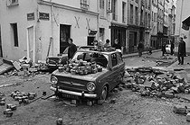 """Events of May-June 1968. Cars and cobblestones the day after the night of the barricades. Corner of the rue du Pot de fer and the rue Tournefort. Paris (Vth arrondissement), on June 12, 1968. Photograph by Michel Robinet, from the collections of the French newspaper """"France-Soir"""". Bibliothèque historique de la Ville de Paris. © Michel Robinet / Fonds France-Soir / BHVP / Roger-Viollet"""