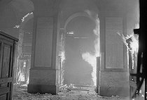 """Events of May-June 1968. Fire at the Paris Stock Exchange, on May 24, 1968. Photograph by Robert Girardin, from the collections of the French newspaper """"France-Soir"""". Bibliothèque historique de la Ville de Paris. © Robert Girardin / Fonds France-Soir / BHVP / Roger-Viollet"""