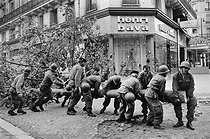 """Events of May-June 1968. Barricades are cleared by military forces, boulevard Saint-Michel. Paris (Vth-VIth arrondissement), on May 25, 1968. Photograph by  Bernard Charlet and Daniel Lapied, from the collections of the French newspaper """"France-Soir"""". Bibliothèque historique de la Ville de Paris. © Charlet,Lapied / Fonds France-Soir / BHVP / Roger-Viollet"""