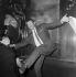 Henri Salvador (1917-2008), chanteur et auteur-compositeur français, lors d'une répétition avec Régine (née en 1929), chanteuse française. France, vers 1955. © Jacques Cuinières / Roger-Viollet
