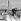 """Eric Tabarly (1931-1998), navigateur français, sur son bateau """"Pen Duick III"""", avec l'un de ses équipiers : Yves Guégan. La Trinité-sur-Mer (Morbihan), 1968. © Jacques Cuinières / Roger-Viollet"""