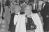"""Soirée Vogue """"Paris en fête, Paris en vogue"""". Line Renaud (née en 1928) accompagnée de son mari Louis Gasté (1908-1995) dit Loulou. Champ-de-Mars. Paris. 14 juin 1985. Paris, bibliothèque de l'Hôtel de Ville. © Raymond Mesnildrey / BHdV / Roger-Viollet"""