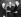 """James Killian (1904-1988), président de la Massachusetts Institute of Technology, remettant une médaille d'or à Niels Bohr (1885-1962), physicien danois. Cette récompense, l'""""Atoms for Peace Award"""", correspond à une donation d'un million de dollars récompensant des contributions importantes pour l'utilisation à des fins pacifiques de l'énergie nucléaire. Au centre : Dwight D. Eisenhower (1890-1969), président des Etats-Unis. Washington D.C. (Etats-Unis), 27 octobre 1957. © Ullstein Bild / Roger-Viollet"""